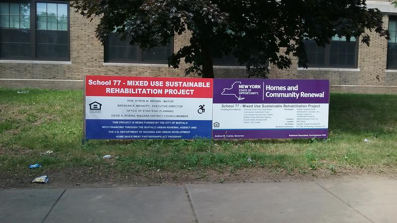 Sign outside former school that was rehabbed to include 30 apartments for seniors.
