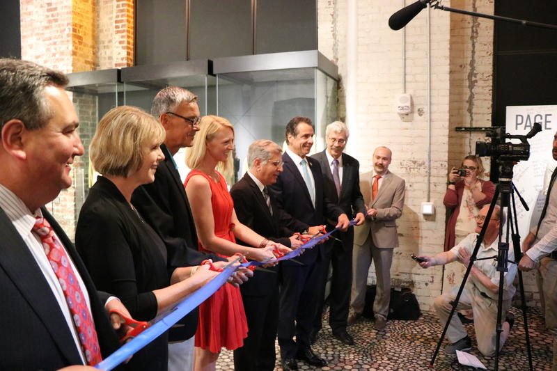 Executive Director Journey Gunderson, Project Chair Tom Benson, and elected officials cut the ceremonial ribbon on the National Comedy Center