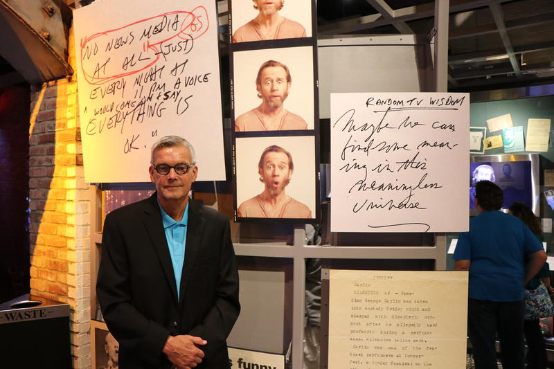 National Comedy Center Project Chair Tom Benson in front of the George Carlin exhibit
