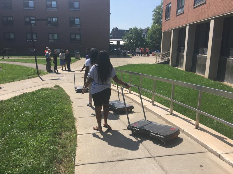 New students, parents & family members rolled carts filled with suitcases, bedding, mini-refrigerators and other college dorm items into Buff State's Porter Hall.