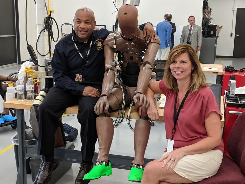 New York State Assembly Speaker Carl Heastie and Assembly Member Monica Wallace get friendly with a high-priced crash-test dummy named Thor