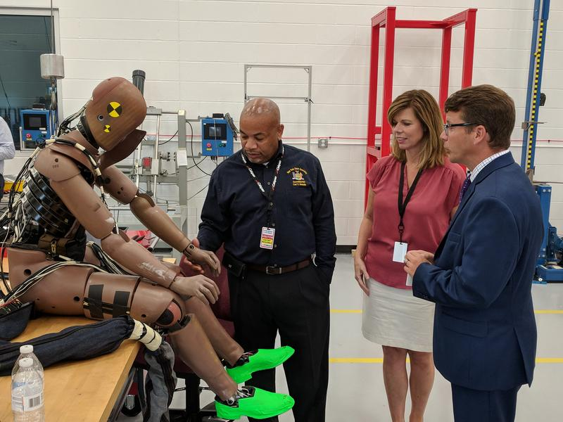 New York State Assembly Speaker Carl Heastie inspects Thor, the high-tech crash-test dummy at Calspan in Cheektowaga