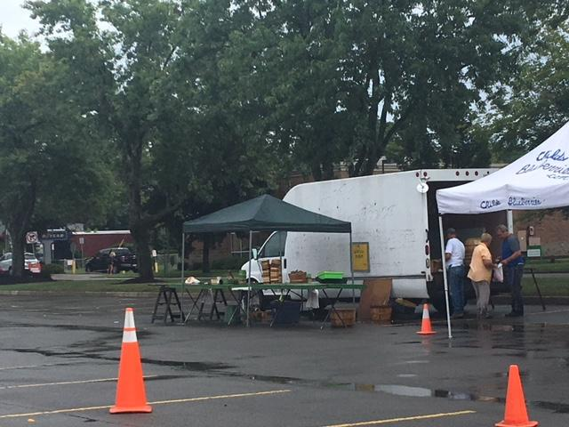 Vendors at the East Aurora Farmers Market at the Aurora Village Shopping Center on Grey Street for their reaction to the Collins indictment and arrest.