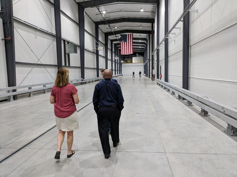 New York State Assembly Speaker Carl Heastie and Assembly Member Monica Wallace tour the 650-foot crash-test track at Calspan in Cheektowaga