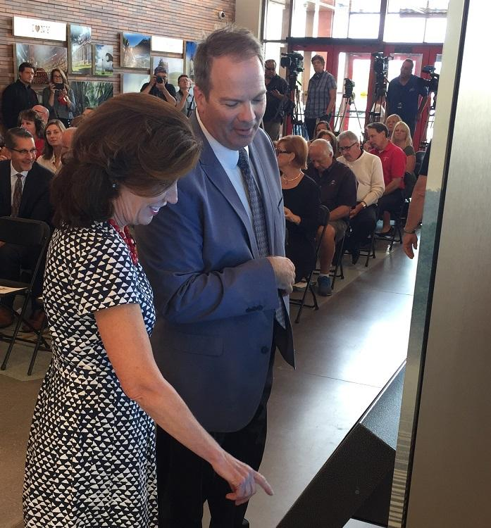 Lieutenant Governor Kathy Hochul samples one of the interactive boards within the Western New York Welcome Center.