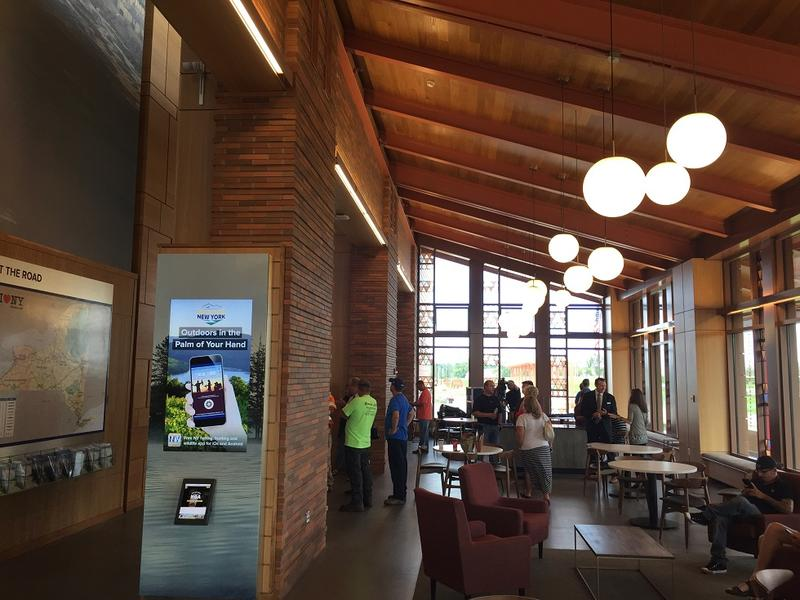 A view from inside the newly-opened Western New York Welcome Center. In addition to the large space with tables and chairs seen here, meeting rooms have been built within the facility to host community gatherings.