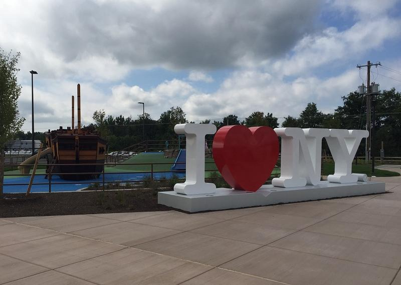 "Outside the Western New York Welcome Center there's an ""I Love NY"" sculpture and a children's playground featuring a ""Great Lakes shipwreck"" theme."