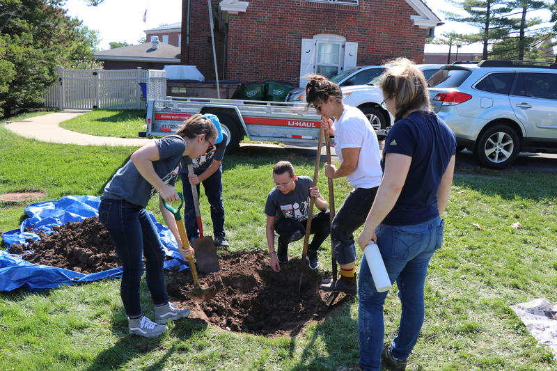 Students dig a pit for cooking ancient foods during Buffalo State College's 'Days of Fire' event hosted by the Garman Art Conservation Department.