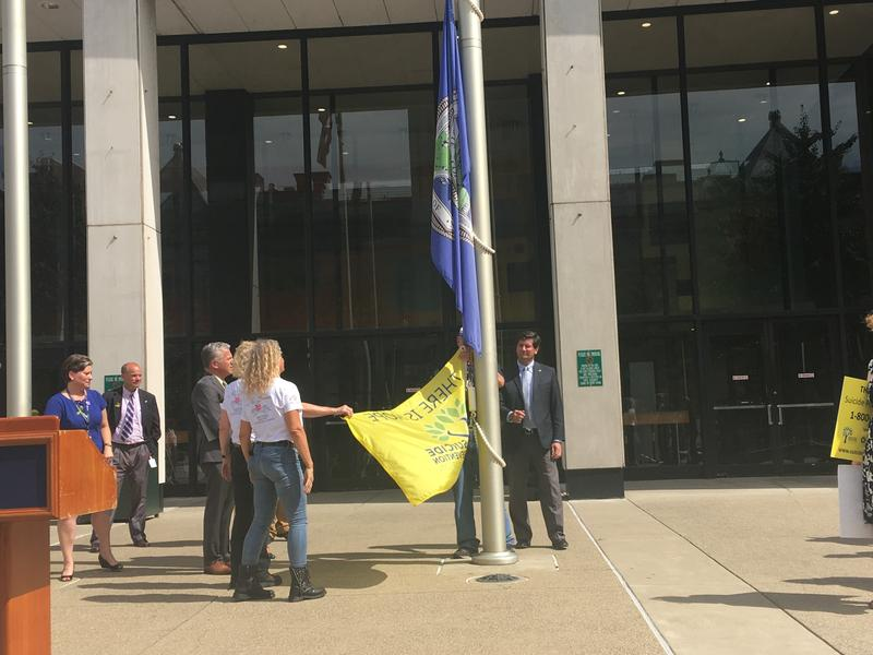 A yellow 'Flag of Hope' was hoisted up the flag pole at  Rath Building.