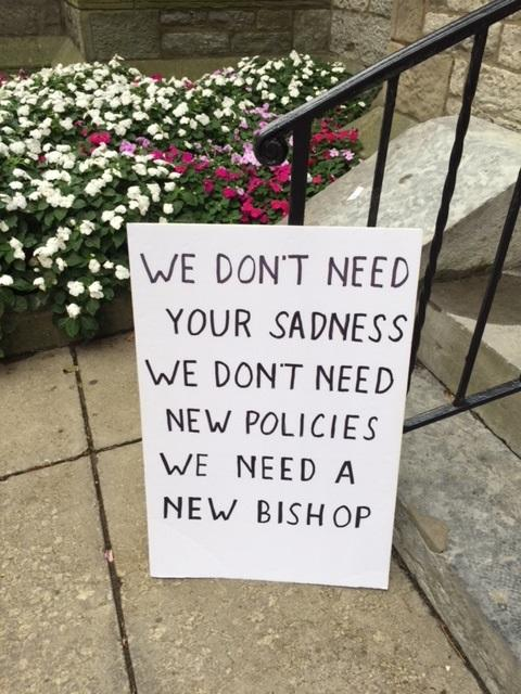 A small group of protesters called for the bishop's resignation.