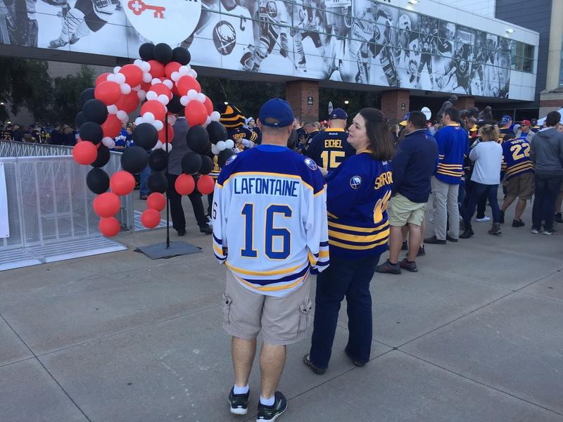 Sabres fans line up outside KeyBank Center before Thursday night's NHL season-opening game.