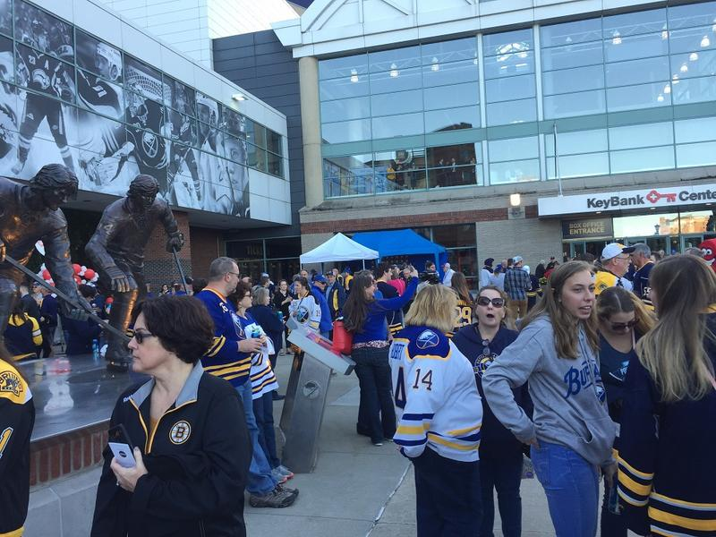 "Fans take advantage of the weather as they ""party in the plaza"" prior to the start of Thursday's Buffalo Sabres game, the first of the 2018-19 season."