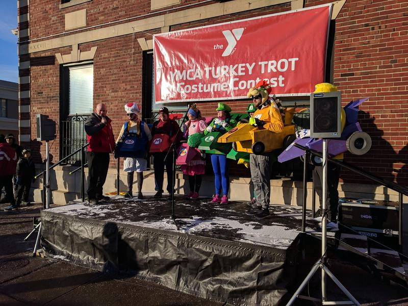 Runners participate in the Turkey Trot in all kinds of costumes, including the cast of Mario Kart.