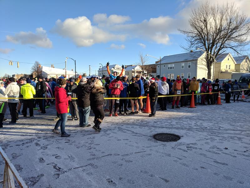 Runners crowd the starting line on Delaware Avenue.