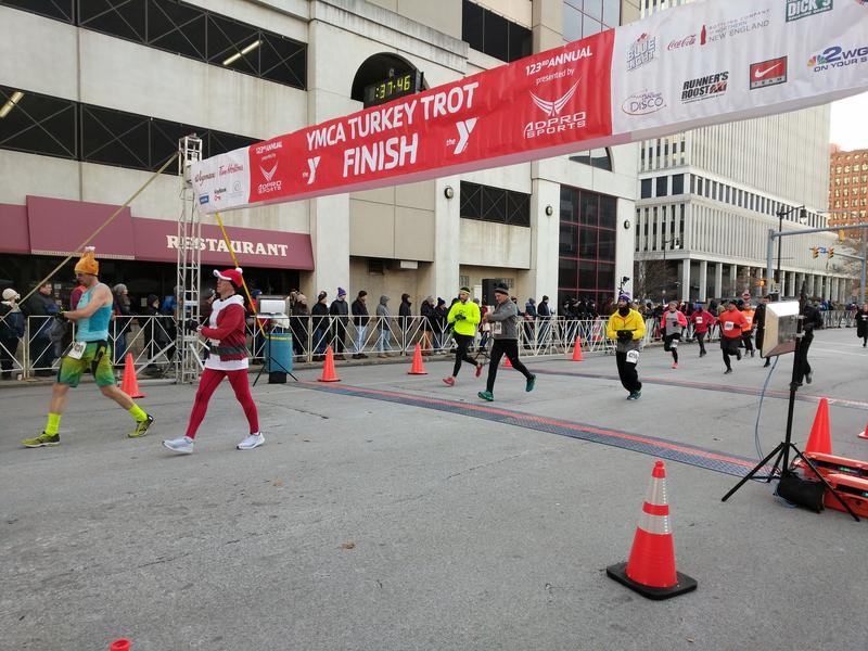 Runners cross the finish line in Buffalo's 123rd annual YMCA Turkey Trot.