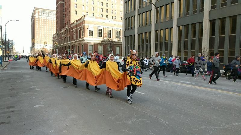 A 'turkey train' of runners makes its way down Delaware Avenue.
