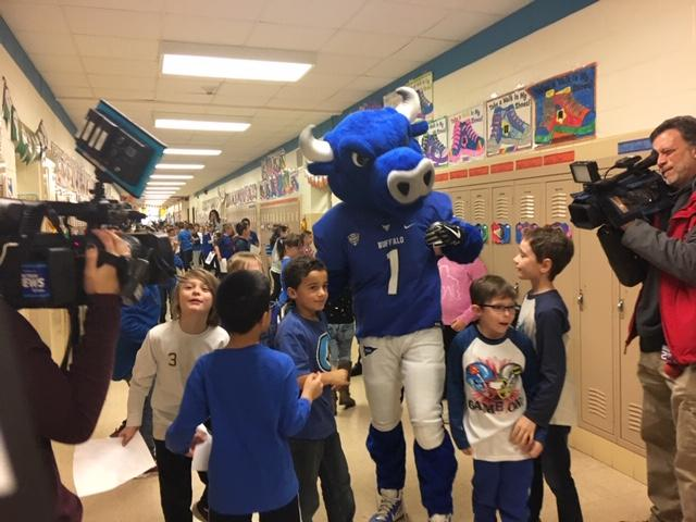 UB Bulls mascot surrounded by excited studetns.