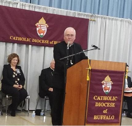 Bishop Richard Malone (at podium) addresses local media before attending the U.S. Conference of Catholic Bishops.