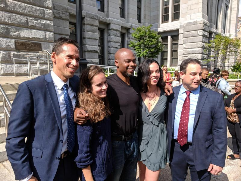 Valentino Dixon (center) in September, surrounded by those who helped vacate his murder conviction.