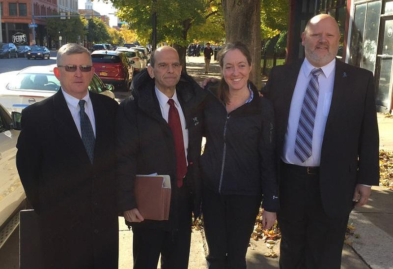 Attorney Mitchell Garabedian (second from left) stands with whistleblowers on the Buffalo Catholic Diocese in October.