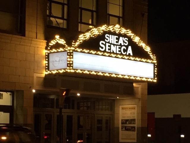 The marquee lights up Seneca Street.