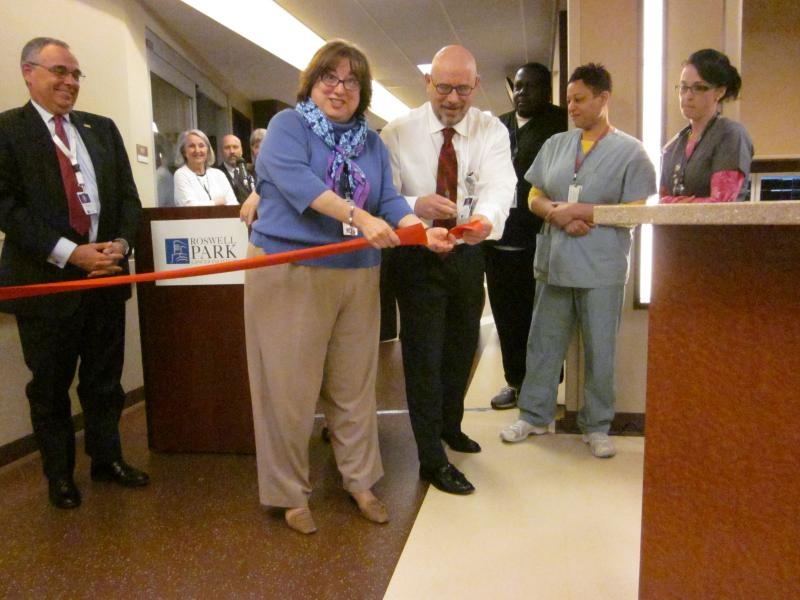 Chief Nursing Officer Maureen Kelly cuts the ribbon on Roswell Park's new ICU.