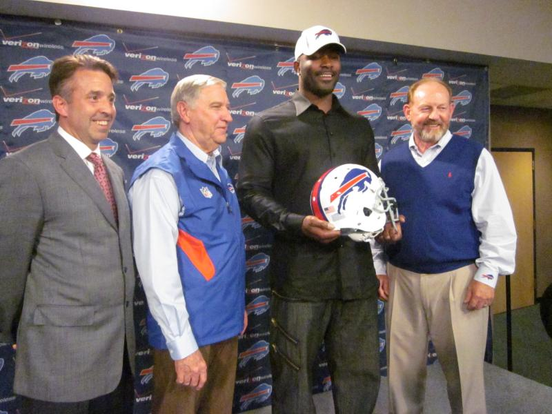 CEO Russ Brandon, GM Buddy Nix, DE Mario Williams, and head coach Chan Gailey