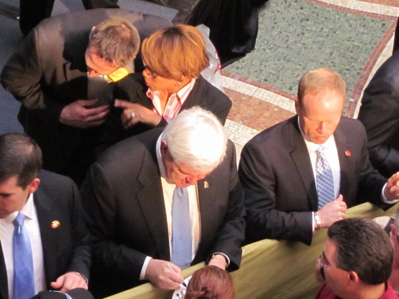 Newt Gingrich signs autographs