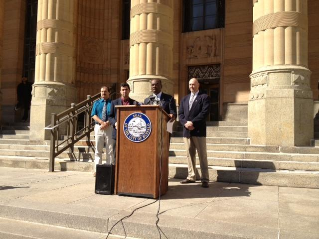 Mayor Byron Brown announces easing winter parking rules from steps of City Hall