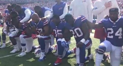 LeSean McCoy, Bills running back, stretches during the national anthem
