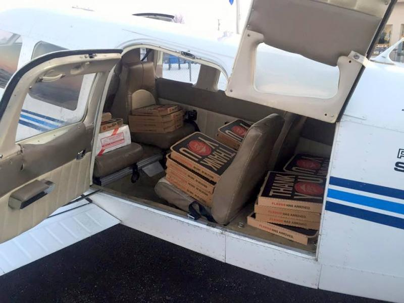 Dustin Shaffer delivers pizza to the island in December