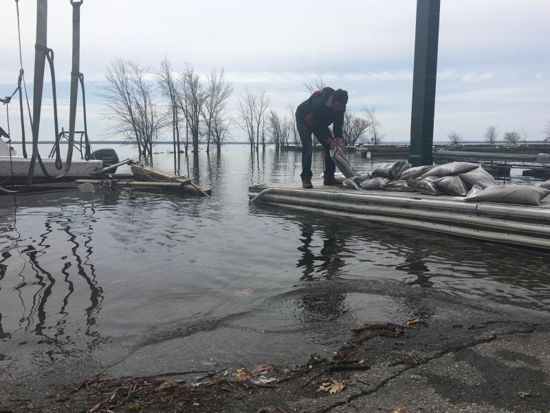 Workers pile sandbags along Lake St. Louis
