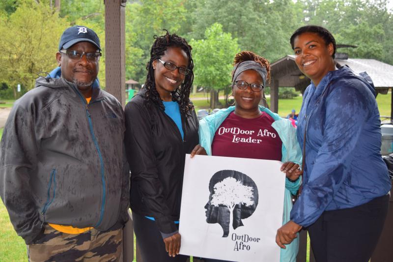 A few members of Outdoor Afro Cleveland, including Smith-Woodford (holding sign)