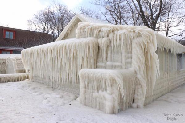 """Frozen in Time"" -- Spray from Lake Ontario covered this New York house with ice last winter."