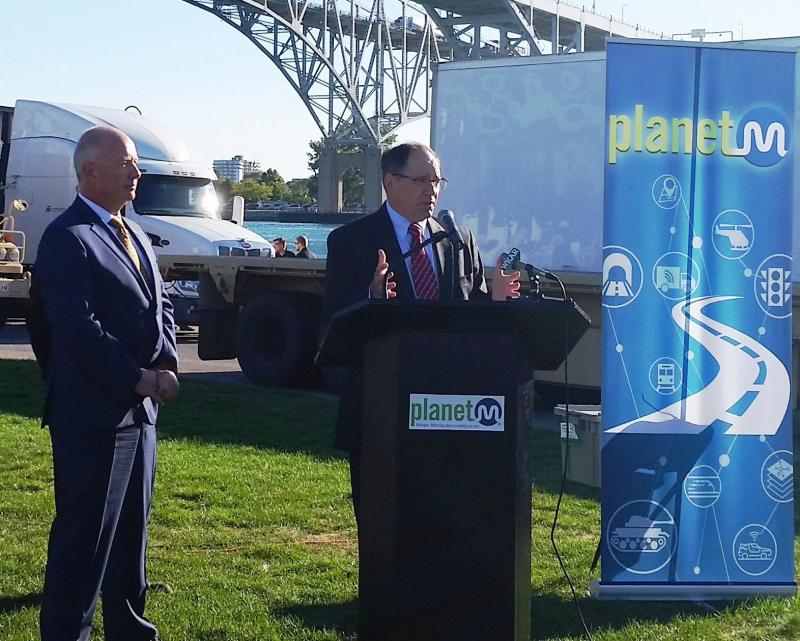 Paul Rogers (on right), director of Tank Automotive Research, Development and Engineering Center, and Kirk Steudle, director of Michigan Department of Transportation