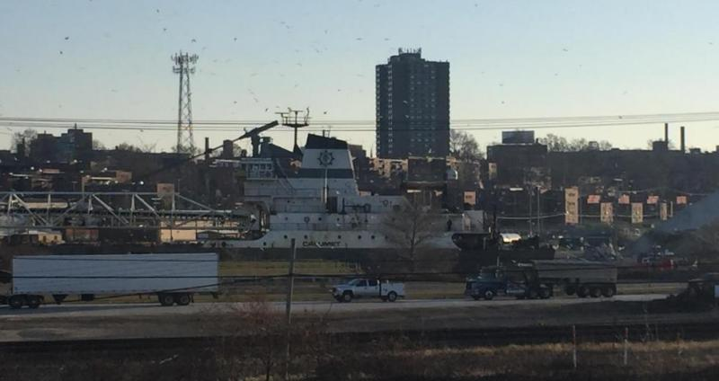 A ship travels the Cuyahoga River