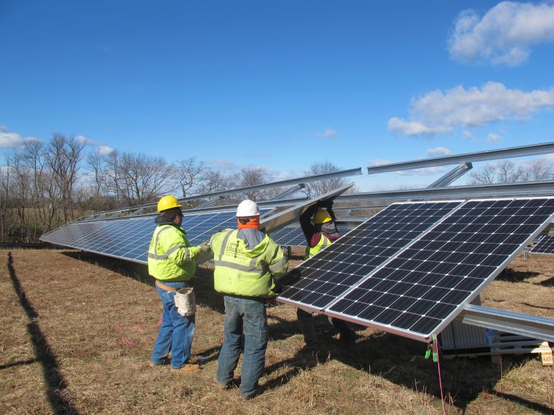 Workers install solar panels at project being constructed at Delaware Valley Regional High School in Frenchtown.