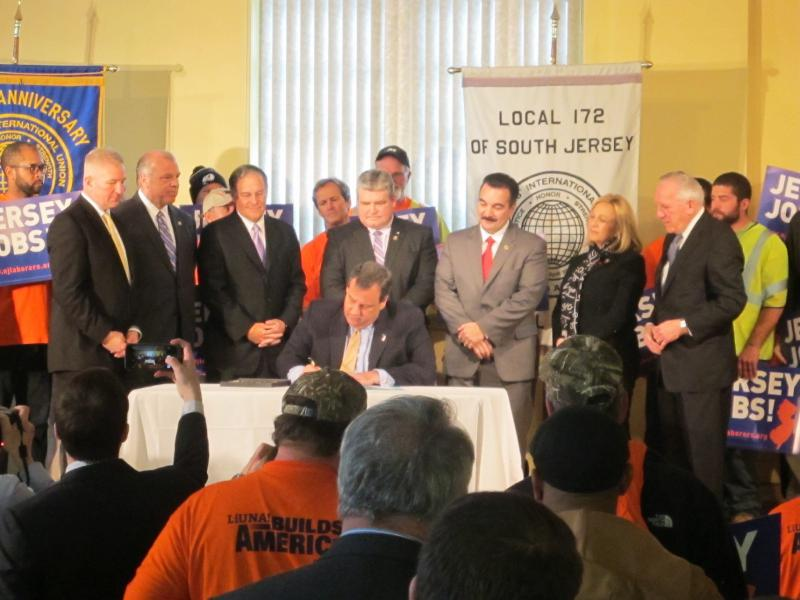 Governor Christie signs the legislation at laborers union hall in Trenton