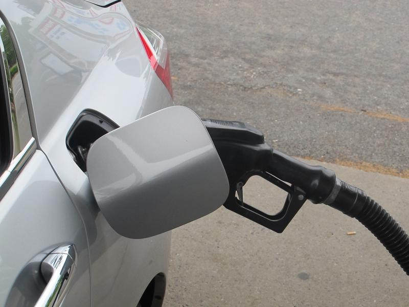 gas nozzle in tank of car