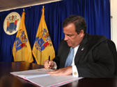 Christie signs the law