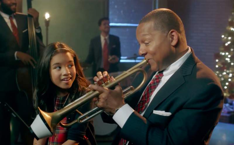 Wynton Marsalis with his daughter Oni and members of the Jazz at Lincoln Center Orchestra