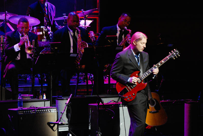 Derek Trucks (right) performing with the Jazz at Lincoln Center Orchestra, led by Wynton Marsalis (at far left)