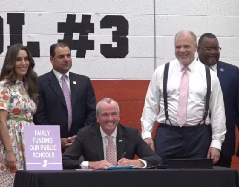 Governor Phil Murphy signs the new school funding law.