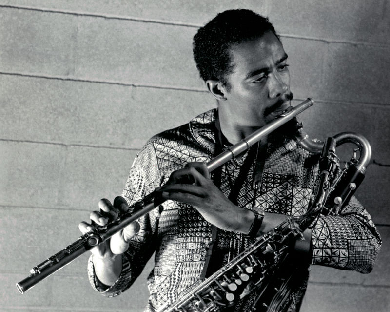 Eric Dolphy with all three of his trademark instruments: flute, alto saxophone and bass clarinet