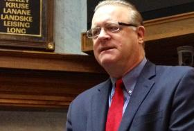 Indiana Senate President Pro-Tem David Long talks with reporters.