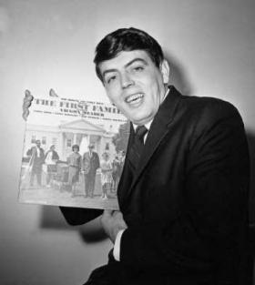 "Comedian Vaughn Meader, in a publicity photo for his Kennedy-themed album, ""The First Family."""