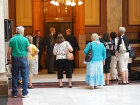 A handful of protesters gathered at the Indiana Statehouse earlier this month to share their views with the Mount Vernon Assembly.