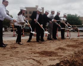 Mayor Tom Henry, Tim Ash, Bill Bean and others officially break ground on new downtown development.