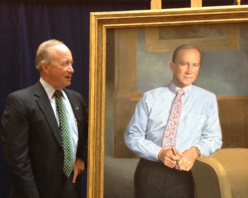 Governor Mitch Daniels poses with his official portrait, unveiled Tuesday. The Indiana Governors Portraits Collection now totals 53 such works.
