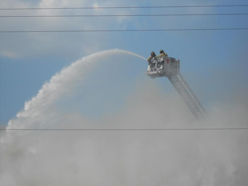 Firefighters battle a massive fire near 1200 Herbert St. Monday on downtown Fort Wayne's east side.